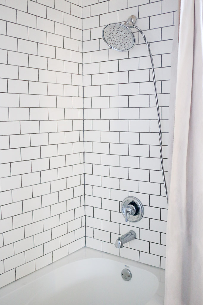 Chrome Bathroom Hardware, white subway tile with dark grout