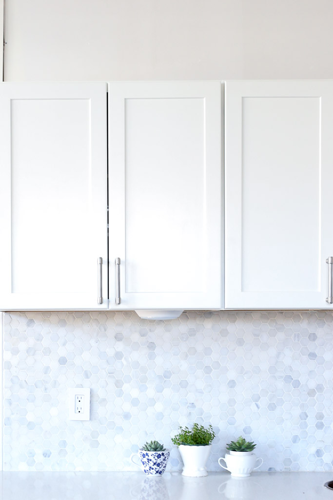 White Cabinets, Brushed Nickel Hardware, Marble Backsplash Mamas Dance-1