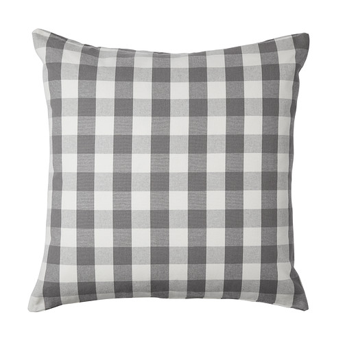white and grey check pillow