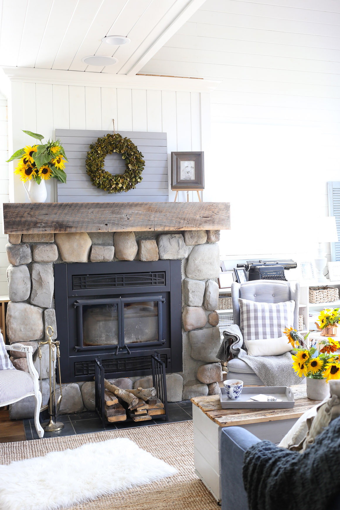 farmhouse-mantel-decor-sunflowers-and-a-boxwood-wreath-3