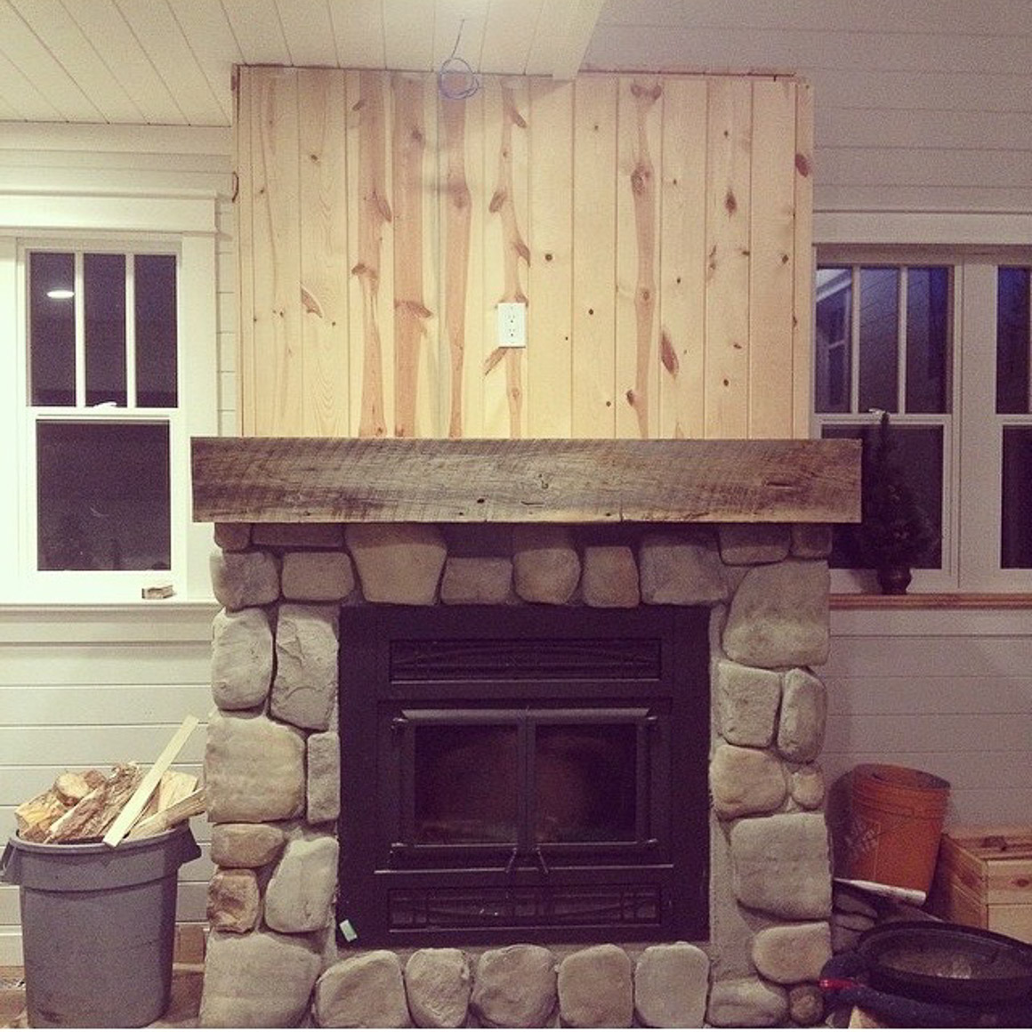 stone-face-fireplace-with-rustic-wood-mantel-4